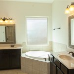 Master Bathroom features His and Hers closets and a pass through