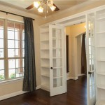 Office/Study with built-in bookshelves and French Doors.